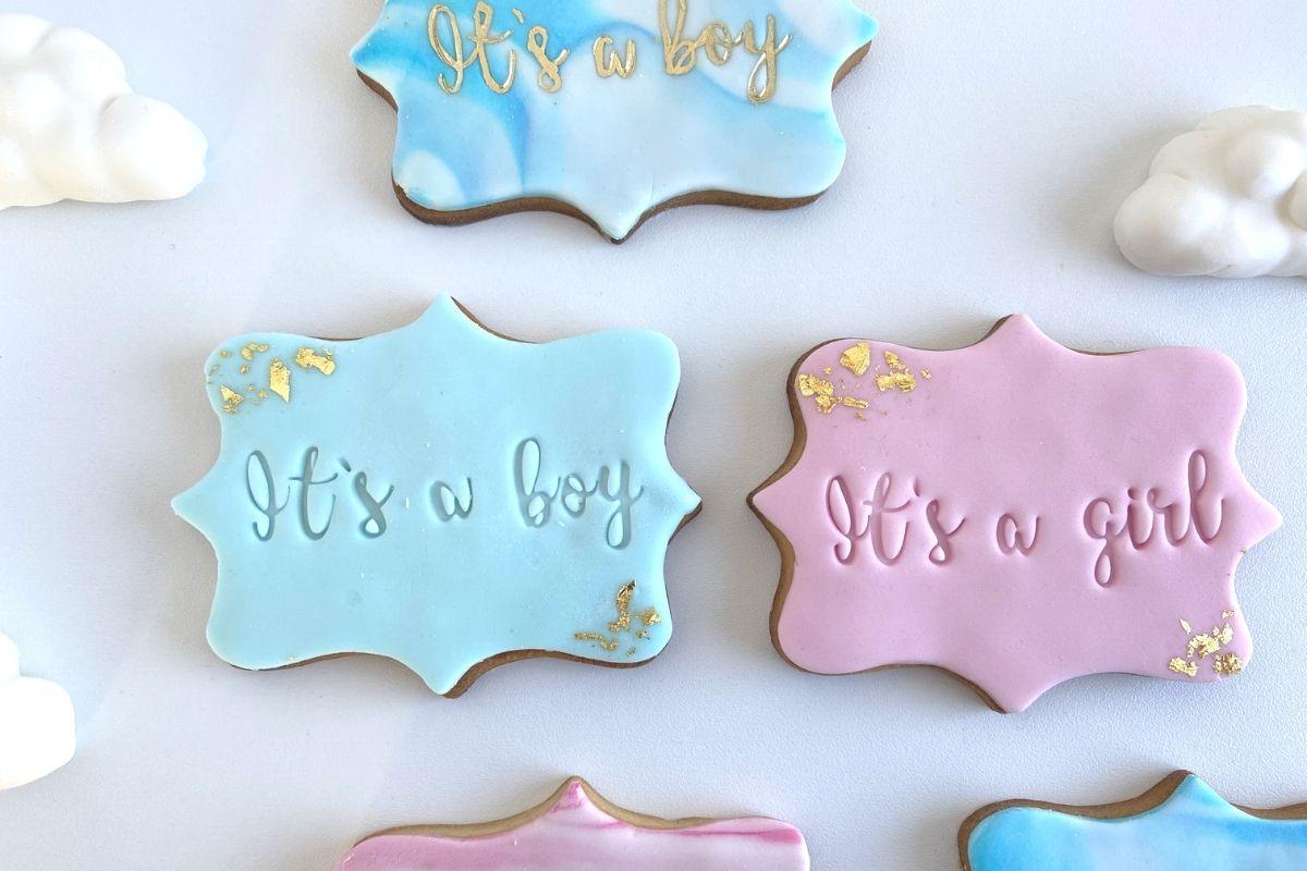 biscotti decorati baby shower azzurro rosa it's a boy it's a girl pasta di zucchero cornice
